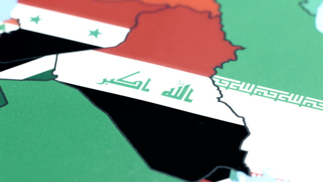 iraq with national flag on world map - iraqi flag stock videos and b-roll footage