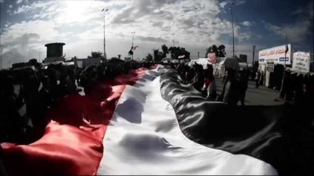 iraqi anti government demonstrators protest in the central city of najaf reviving the opposition movement against the authorities and adding... - najaf video stock e b–roll