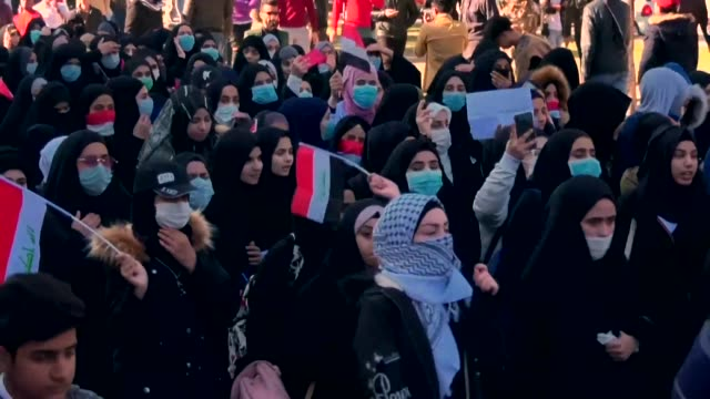 iraqi anti government protesters take to the streets in the shrine city of karbala to denounce violence against activists - karbala stock videos & royalty-free footage
