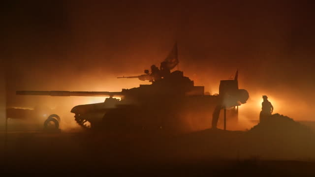 iraqi army tanks and armoured vehicles moving at night as they prepare to liberate mosul from islamic state - tank stock videos and b-roll footage