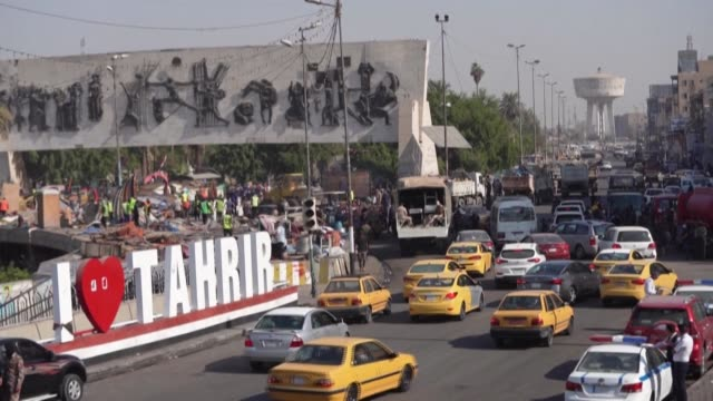 iraqi authorities reopen tahrir square to traffic in central baghdad, in a sign of easing tensions a year after the launch of an anti-government... - baghdad stock videos & royalty-free footage