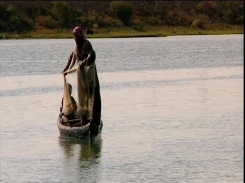 Iraqi fisherman casts net on River Tigris Qurna