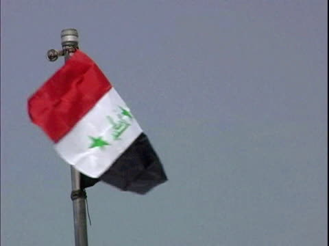 iraqi flag blowing in wind / mahmudiyah iraq / audio - iraqi flag stock videos and b-roll footage