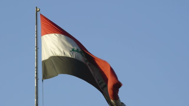iraqi flag flies, medium shot - iraqi flag stock videos and b-roll footage