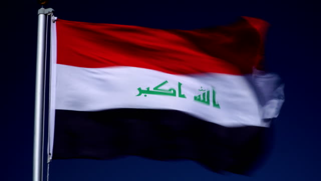 4k: iraqi flag on flagpole in front of blue sky outdoors (iraq) - iraqi flag stock videos and b-roll footage