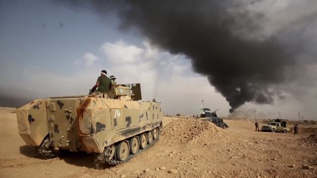 Iraqi forces and members of the Hashed alShaabi were on the edge Friday of the city of al Qaim in Iraq's western Anbar province near the Syrian...