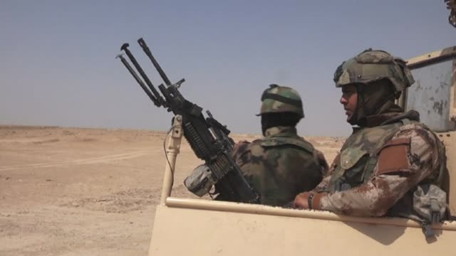 Iraqi forces backed by paramilitary units were preparing Monday to attack the last stronghold of the Islamic State group in the western desert...