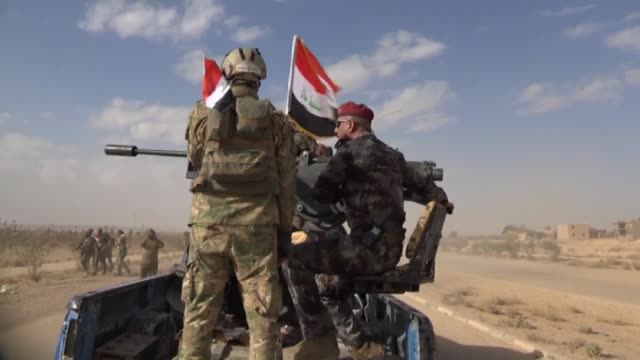 Iraqi forces on Tuesday battled up to the edge of Al Qaim the largest town still held by the Islamic State group in the country as they pushed a...