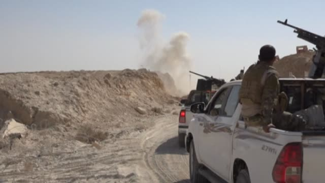 Iraqi forces on Tuesday battled up to the edge of AlQaim the largest town still held by the Islamic State group in the country as they pushed a final...
