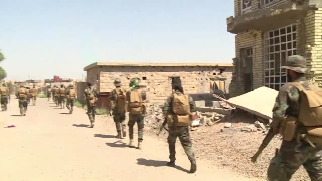 iraqi forces stalled at the fringes of fallujah slowed in their advance wednesday by concerns over the fate of trapped civilians and resistance from... - al fallujah stock videos and b-roll footage