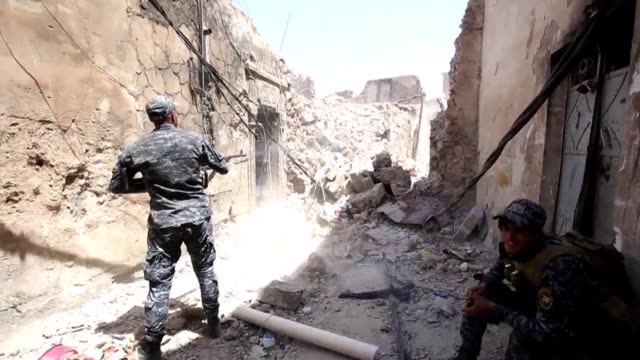 iraqi forces were pushing inside the old city of mosul on wednesday where a few hundred jihadists are believed to be holed up - mosul stock videos and b-roll footage
