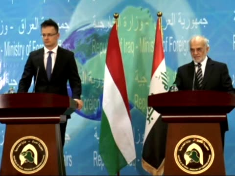 iraqi foreign minister ibrahim aljaafari and hungarian minister of foreign affairs and trade peter szijjarto attend a joint press conference... - hungarian culture stock videos & royalty-free footage