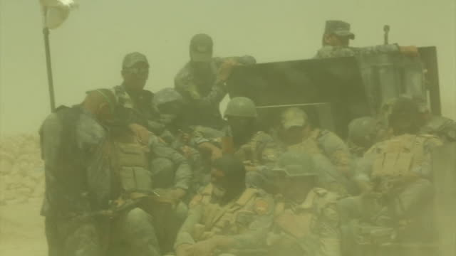 iraqi government forces moving into fallujah on tanks and vehicles to battle islamic state fighters - al fallujah bildbanksvideor och videomaterial från bakom kulisserna