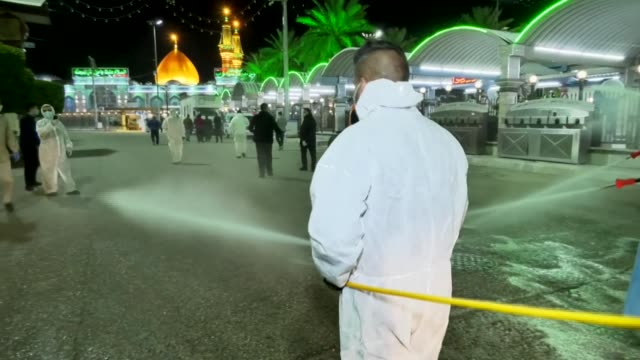 iraqi health workers disinfect the area around the shrines of imam hussein and imam abbas in the central iraqi holy city of karbala amidst efforts... - karbala stock videos & royalty-free footage