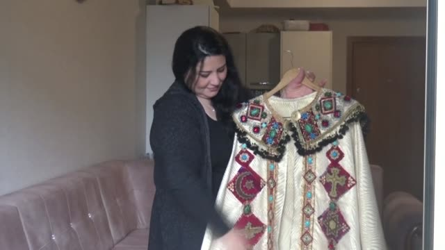 Iraqi Kurdish artist Shanaz Jamal embroiders a robe ornated with a big cross one of the religious symbols of the communities living in Iraq's multi...