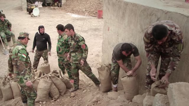 Iraqi Kurdish fighters are building a berm in the desert near Mosul that could demarcate a boundary of the state they hope to establish after the...