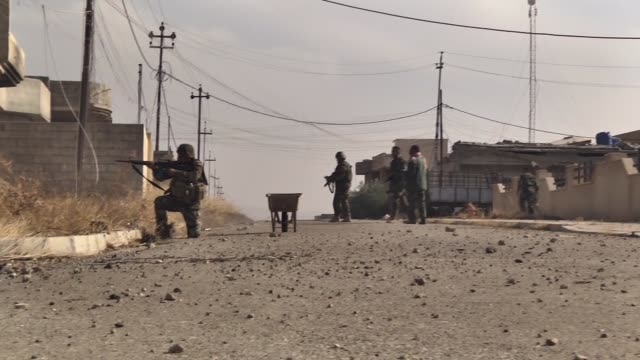 Iraqi Kurdish Regional Government's peshmerga forces attack Daesh terrorists as they move towards Bashiqa center during the operation to clear...