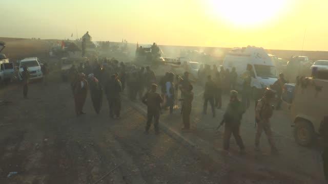 stockvideo's en b-roll-footage met iraqi kurdish regional government's peshmerga forces move towards bashiqa center during the operation to clear bashiqa town as the operation to... - isis