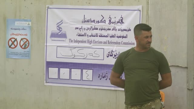 iraqi kurdish voters cast their ballots in the kurdish independence referendum at a polling station in kirkuk on september 25 2017 voting began early... - referendum stock videos & royalty-free footage