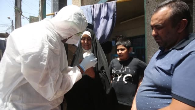 iraqi medical staffers test the residents of sadr city, on the outskirts of baghdad, for novel coronavirus as part of measures to curb the spread of... - iraq video stock e b–roll