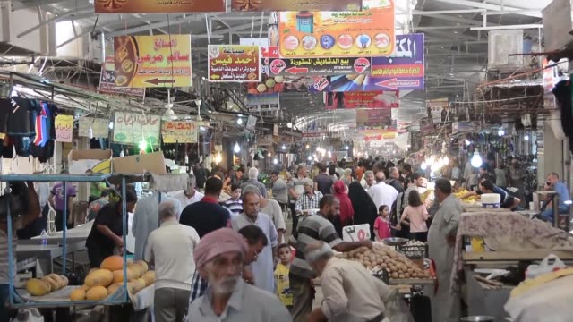 Iraqi merchants and shoppers jostle in the lively open air market of Gogjali on the eastern edges of Mosul their voices often drowned out by the...