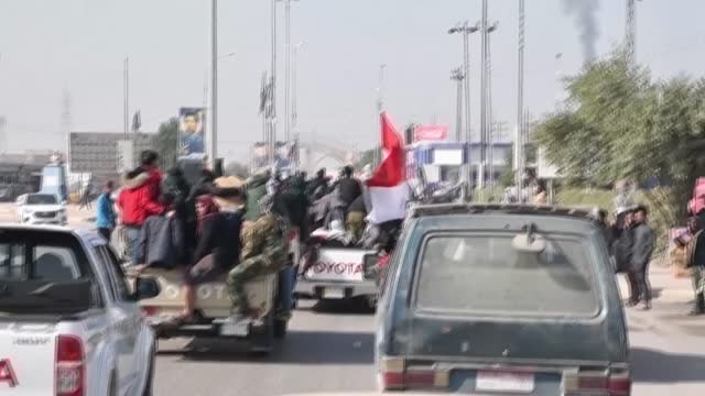 iraqi mourners arrive in a funerary convoy transporting the bodies of members of iraq's state-sponsored hashed al-shaabi force to the southern city... - najaf stock videos & royalty-free footage