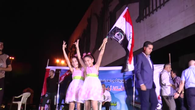 iraqi people celebrate the liberation of mosul at tahrir square in baghdad iraq on july 10 2017 iraqi prime minister haidar alabadi formally declared... - mosul stock videos and b-roll footage