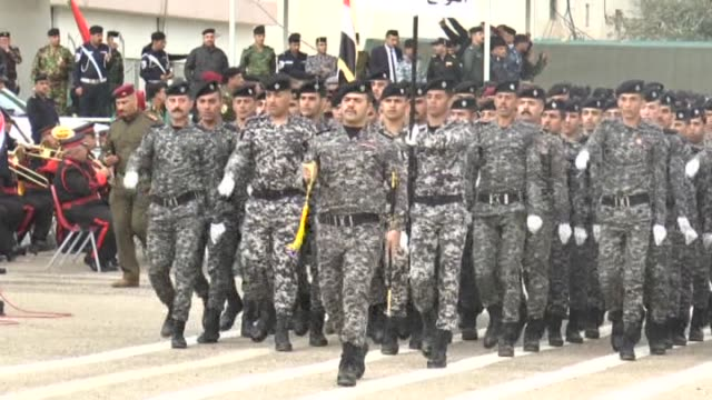 iraqi police forces parade during a ceremony marking the police forces 93rd anniversary in the capital baghdad on january 8 2015 - uniforme militare video stock e b–roll
