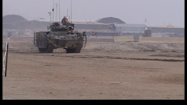 iraqi prime minister calls on american troops in basra; tx iraq: basra: ext various shots of british troops on guard outside air base and general... - army video stock e b–roll
