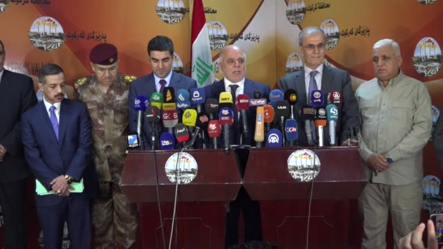 iraqi prime minister haider alabadi hold a press conference with kirkuk governor necmettin kerim undersecretary of the iraqi national security falih... - iraqi prime minister stock videos & royalty-free footage