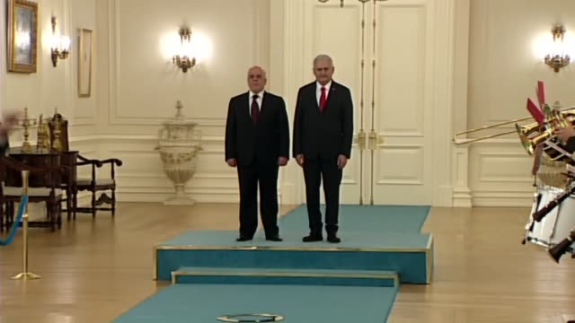 Iraqi Prime Minister Haider alAbadi is welcomed by Turkish Prime Minister Binali Yildirim with an official welcoming ceremony at Cankaya Palace in...