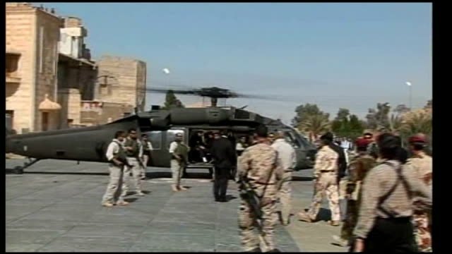 iraqi prime minister meets sunni sheikh abdul sattar iraq anbar province ramadi ext helicopter landing nouri almaliki getting out of helicopter along... - iraqi prime minister stock videos & royalty-free footage