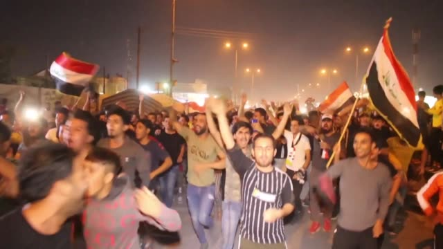 iraqi protesters in basra celebrate football win against iran as a desperately needed morale boost for protesters who have rallied against the... - teheran stock videos & royalty-free footage