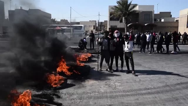 iraqi protesters in the holy city of najaf block roads with burning tyres as violence resurged in the capital and shiite majority south this week... - najaf stock videos & royalty-free footage