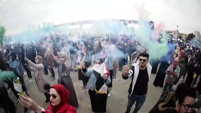 iraqi protesters organise their first colour festival waving coloured smoke flares in the in the holy city of najaf in support of the peaceful... - najaf stock videos & royalty-free footage