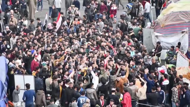 stockvideo's en b-roll-footage met iraqi protesters take to the streets in nasiriyah reviving a months long protest movement against the government and adding criticisms of both the us... - nasiriyah