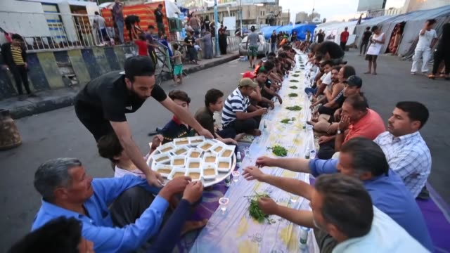 iraqi protesters who have been continuing antigovernment demonstrations at bagdad's tahrir square since last october prepare meals to break their... - ramadan stock videos & royalty-free footage