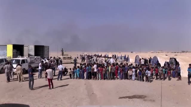 iraqi refugees are seen after they arrive at al qayyarah region at south mosul, on september 04, 2016 after they have fled from daesh controlled... - jihad stock videos & royalty-free footage