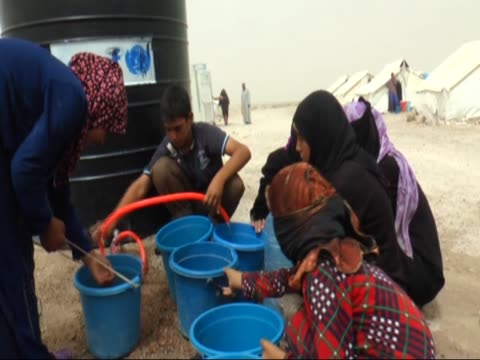 iraqi residents fled from ongoing clashes between iraqi forces and daesh terrorists in fallujah live in harsh conditions ahead of the eid alfitr also... - al fallujah stock videos and b-roll footage