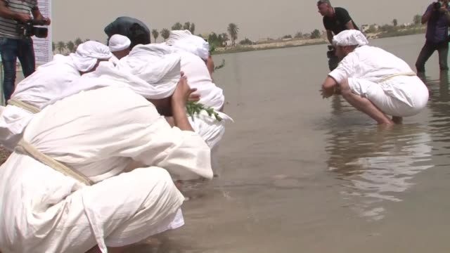 iraqi sabeans, also known in english as mandeans marked eid al khalqeh on the tigris river on wednesday as part of a five day religious holiday - basra video stock e b–roll