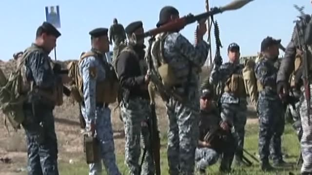 iraqi security forces and shia militias launch a military operation against daesh to retake tikrit city which is under control of daesh, in saladin,... - isil konflikt stock-videos und b-roll-filmmaterial