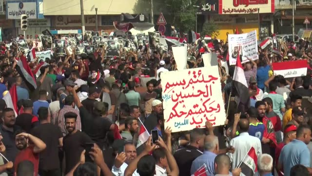 iraqi security forces intervene in demonstrators with water cannons and tear gas canisters as they try to enter baghdad's heavily fortified green... - 放水砲点の映像素材/bロール