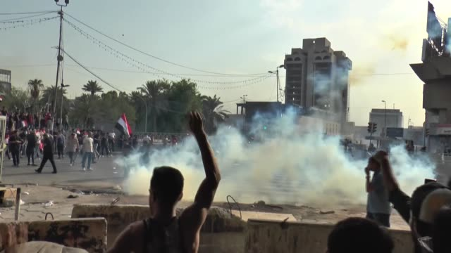 iraqi security forces intervene in demonstrators with water cannons and tear gas canisters as they try to enter baghdad's heavily fortified green... - baghdad stock videos & royalty-free footage