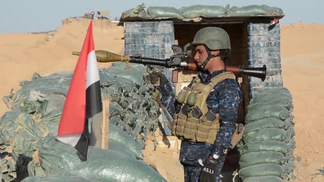 Iraqi security forces members held a position on Sunday as part of their progression towards Salaheddin province in the western desert bordering...