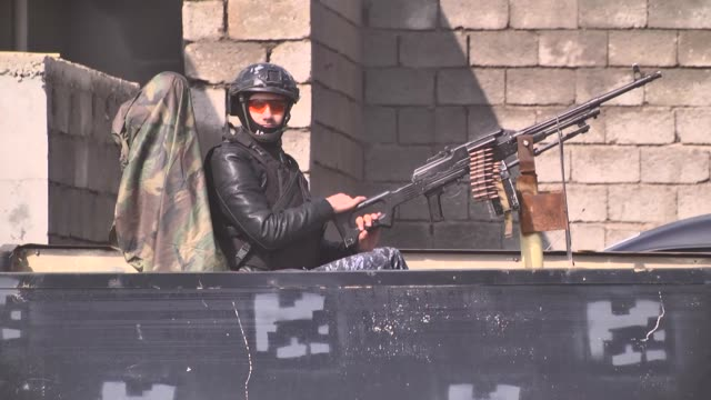 iraqi security forces patrol at the streets of hawija district of kirkuk province, which was cleared from all daesh terrorists, in iraq on february... - isil konflikt stock-videos und b-roll-filmmaterial