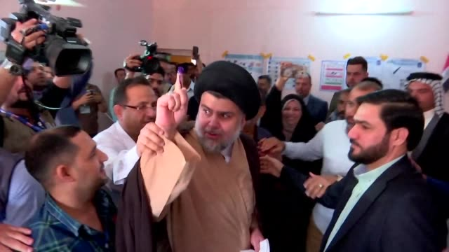iraqi shiite cleric and leader moqtada al sadr casts his vote inside a polling station in the central holy city of najaf as the country votes in the... - najaf stock videos & royalty-free footage