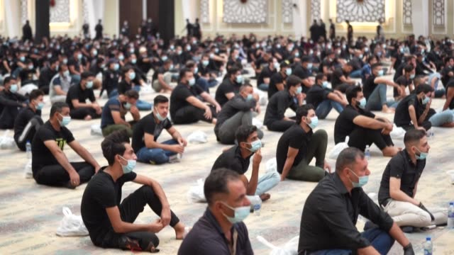 iraqi shiite muslims gather in the capital baghdad, despite calls to stay home as covid-19 spreads, to commemorate the start of the month of... - shi'ite islam stock videos & royalty-free footage