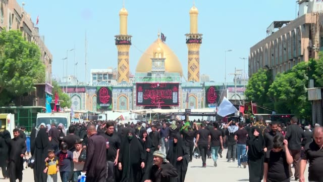 iraqi shiite muslims take part in commemorations in the holy city of karbala marking the 9th day of muharram ahead of ashura - ashura muharram stock-videos und b-roll-filmmaterial