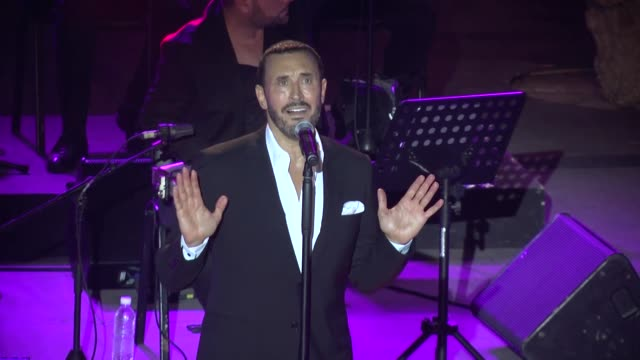 iraqi singer kathem alsaher performs on stage during the 54th edition of the international festival of carthage on july 31 2018 in tunis tunisia - carthage tunisia stock videos & royalty-free footage