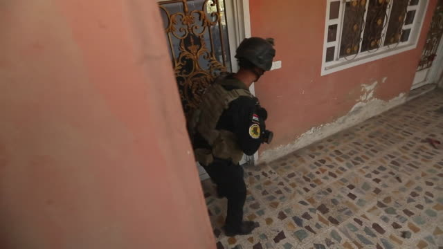 iraqi soldiers breaking into a house formerly used by islamic state fighters in mosul - building entrance stock videos & royalty-free footage